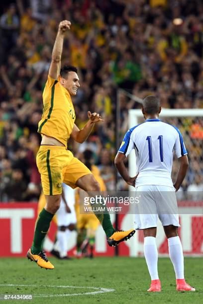 Australia's Trent Sainsbury celebrates a goal beside Honduras' Eddie Hernandez in their 2018 World Cup qualification playoff football match at...