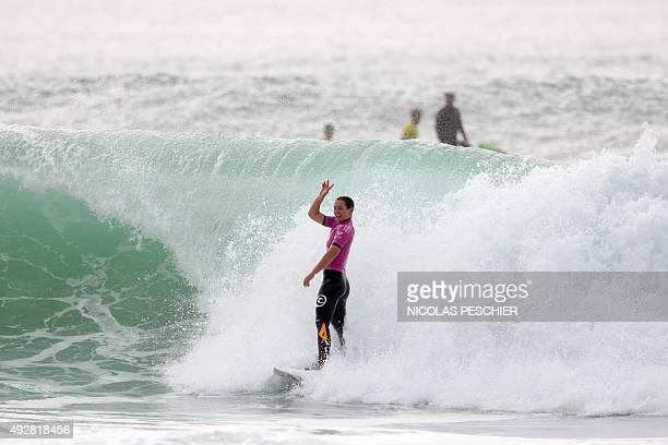 Australia's Tyler Wright celebrates after winning the 2015 World Surfing League Roxy Pro France in Hossegor southwestern France on October 15 2015...