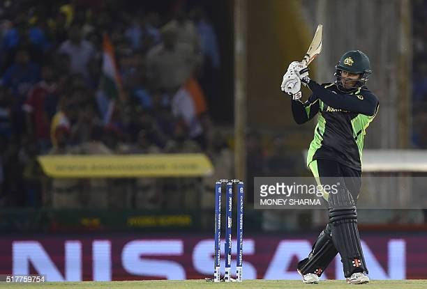 Australia's Usman Khawaja plays a shot during the World T20 cricket tournament match between India and Australia at The Punjab Cricket Stadium...