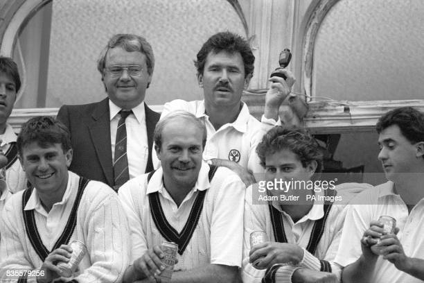 Australia's victorious cricketers celebrate after winning the sixth and final Cornhill Test and the series at the Oval Captain Allan Border holds a...