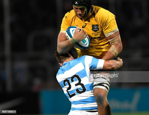 Australia's Wallabies Adam Coleman is tackled by Argentina's Los Pumas Santiago Cordero during the Rugby Championship 2017 test match at Malvinas...