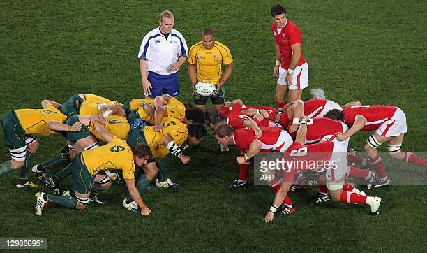 Australia's Wallabies and Wales engage in a scrum during the 2011 Rugby World Cup bronze final match Wales vs Australia at the Eden Park in Auckland...