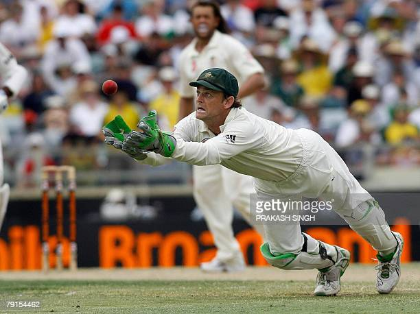Australia's wicket keeper Adam Gilchrist catches the ball to dismiss India's Mahendra Singh Dhoni off Andrew Symonds during day three of the third...