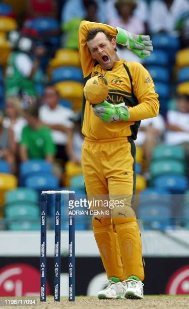 Australia's wicket keeper Adam Gilchrist yawns in between balls during the game against Ireland in the Super-Eight ICC World Cup cricket match at the...