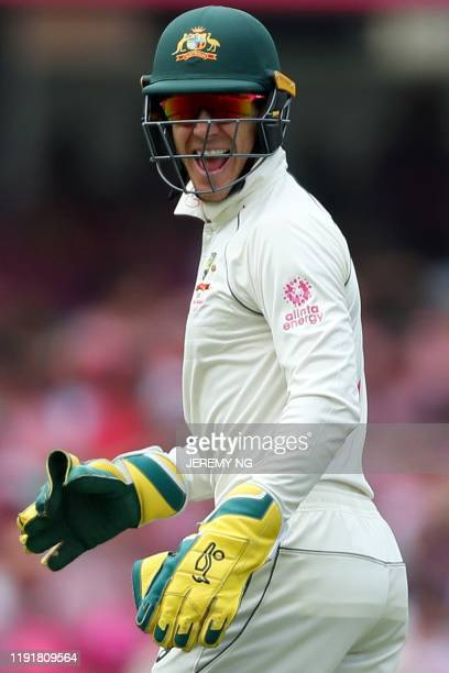 Australias wicketkeeper and captain Tim Paine reacts during the third day of the third cricket Test match between Australia and New Zealand at the...