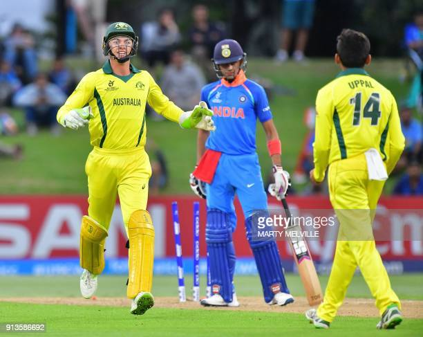 Australia's wicketkeeper Baxter Holt celebrates with teammate Param Uppal after India's Shubman Gill was stumped during the U19 cricket World Cup...