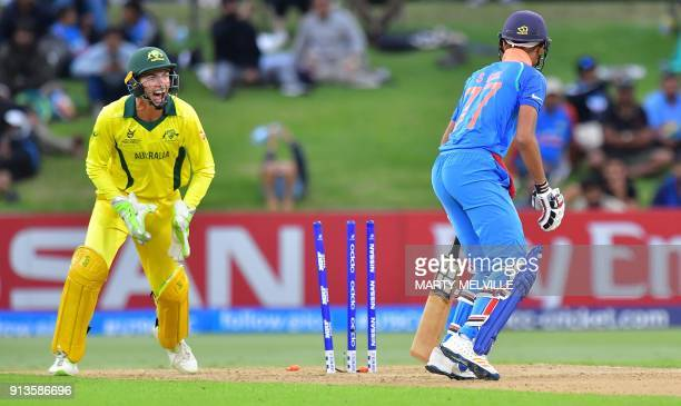 Australia's wicketkeeper Baxter Holt stumps India's Shubman Gill during the U19 cricket World Cup final match between India and Australia at Bay Oval...