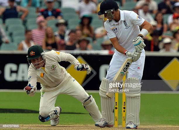 Australia's wicketkeeper Brad Haddin dives for a successfull catch of England's batsman Joe Root to complete his 200 catches in the Test cricket...