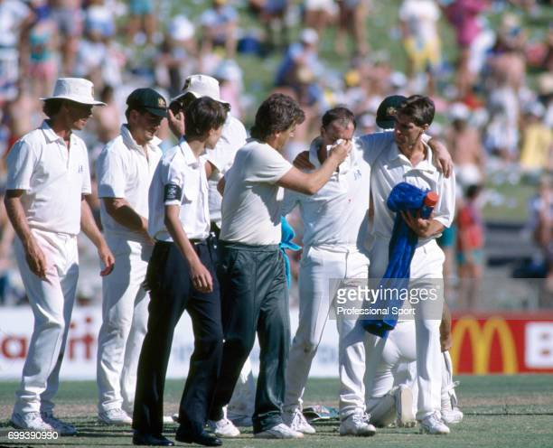 Australia's wicketkeeper Greg Dyer is assisted off the field after suffering a broken nose on the final day of the 3rd Test match between Australia...