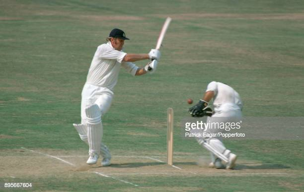 Australia's wicketkeeper Rod Marsh ducks to avoid a shot from England captain Tony Greig during the 2nd Test match between England and Australia at...