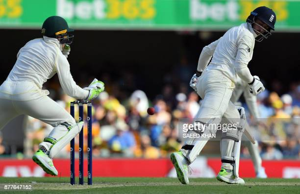 Australia's wicketkeeper Tim Paine drops a possible catch of a ball off the bat of England's James Vince on the first day of the first cricket Ashes...