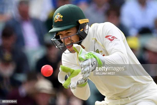 Australia's wicketkeeper Tim Paine reacts as England's batsman Alastair Cook cuts the ball on the fourth day of the second Ashes cricket Test match...