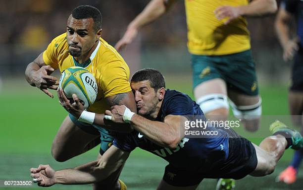 Australia's Will Genia scores a try during the Rugby Championship match between Australia and Argentina in Perth on September 17 2016 / AFP / Greg...