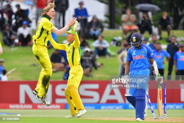 Australia's Will Sutherland celebrates with wicketkeeper Baxter Holt after India's Prithvi Shaw was bowled out during the U19 cricket World Cup final...