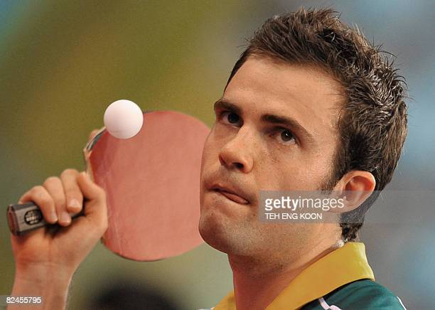Australia's William Henzell plays against Algeria's Idir Khourta in their men's singles preliminary round table tennis match at the 2008 Beijing...