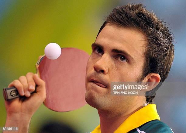 Australia's William Henzell serves to Algeria's Idir Khourta during their men's table tennis single preliminary match as part of the 2008 Beijing...