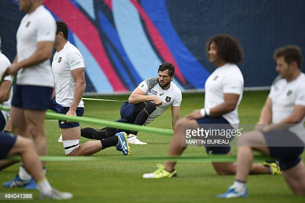 Australia's wing Adam AshleyCooper takes part in a team training session on October 24 in Teddington west of London on the eve of the Rugby Union...