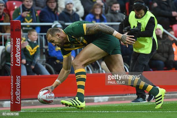 Australia's wing Blake Ferguson scores the team's first try during the rugby league Four Nations Final match at Anfield in Liverpool north west...