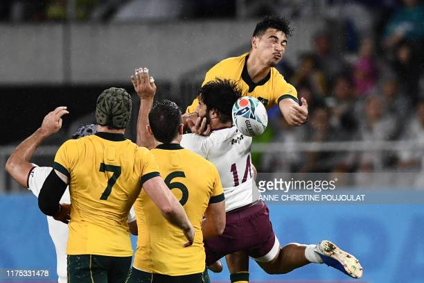 Australia's wing Jordan Petaia and Georgia's wing Giorgi Kveseladze jump for the ball during the Japan 2019 Rugby World Cup Pool D match between...