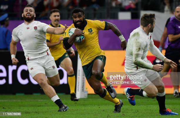 Australia's wing Marika Koroibete runs to attempt to score a try during the Japan 2019 Rugby World Cup quarter-final match between England and...