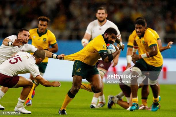 Australia's wing Marika Koroibete runs to score a try during the Japan 2019 Rugby World Cup Pool D match between Australia and Georgia at the...