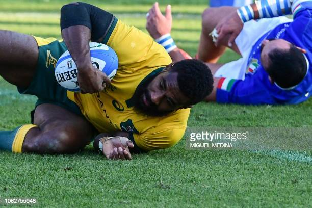 Australia's wing Marika Koroibete scores a try during the international rugby union test match Italy vs Australia on November 17 2018 at the Euganeo...