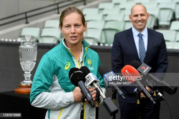 Australia's women's captain Meg Lanning speaks as Cricket Australia Interim CEO Nick Hockley looks on during a press conference announcing the...