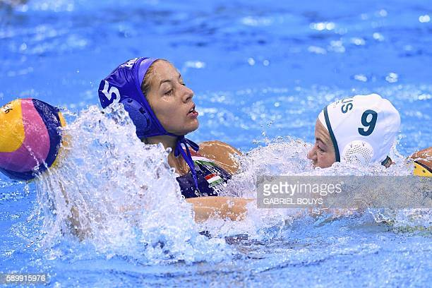 Australia's Zoe Arancini vies for the ball with Hungary's Gabriella Szucs during their Rio 2016 Olympic Games waterpolo qauerterfinal match at the...