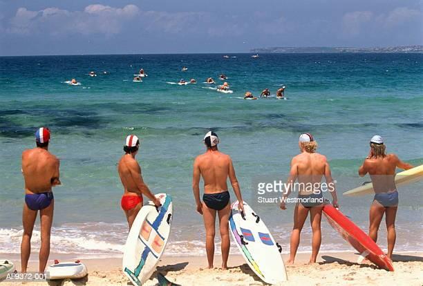 australia,sydney,competitors in bondi beach lifeguard race - bondi beach stock pictures, royalty-free photos & images