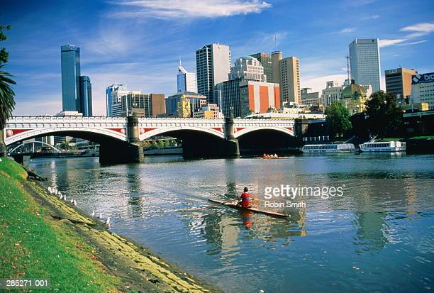 Australia,Victoria,Melbourne,Yarra River,city skyline in background