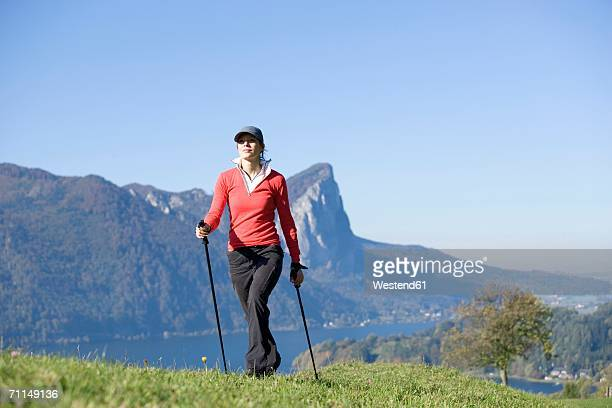 Austria, alps, woman exercising Nordic walking