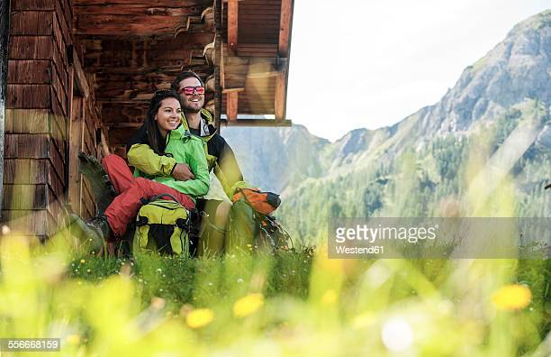 Austria, Altenmarkt-Zauchensee, young couple at alpine cabin