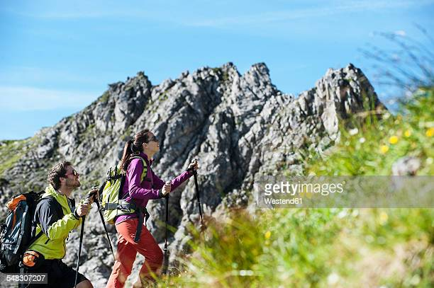 Austria, Altenmarkt-Zauchensee, young couple hiking at Niedere Tauern