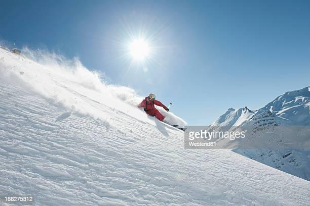 Austria, Arlberg. Man skiing downhill
