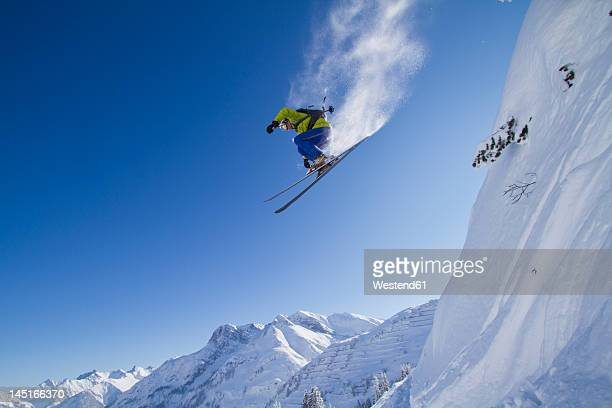 austria, arlberg, warth, mid adult man skiing - ski jumping stock pictures, royalty-free photos & images