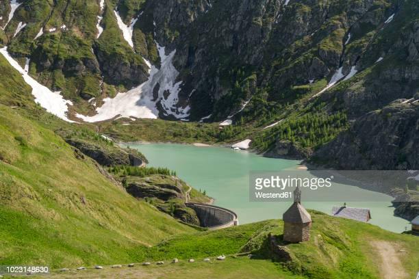 austria, carinthia, high tauern national park, sacred heart chapel at margaritze reservoire - carinthia stock pictures, royalty-free photos & images