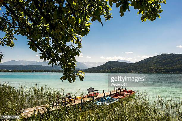 austria, carinthia, jetty at lake woertherses - carinthia stock pictures, royalty-free photos & images