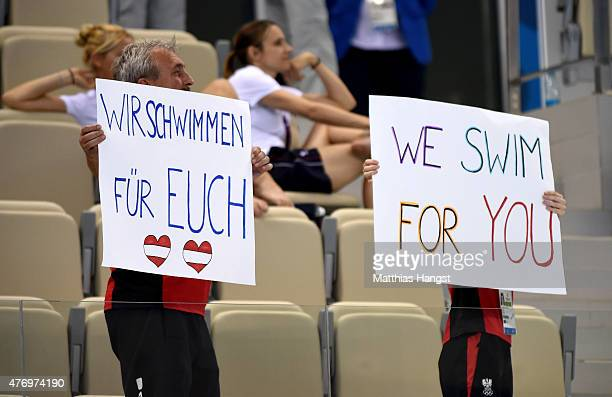 Austria coaches cheer on their team in the Synchronised Swimming Free Combination quailification during day one of the Baku 2015 European Games at...