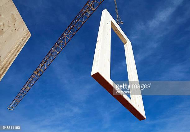 Austria, Cranes lifting Framing components