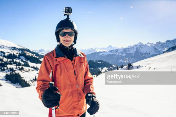 Austria, Damuels, skier with action cam in winter landscape