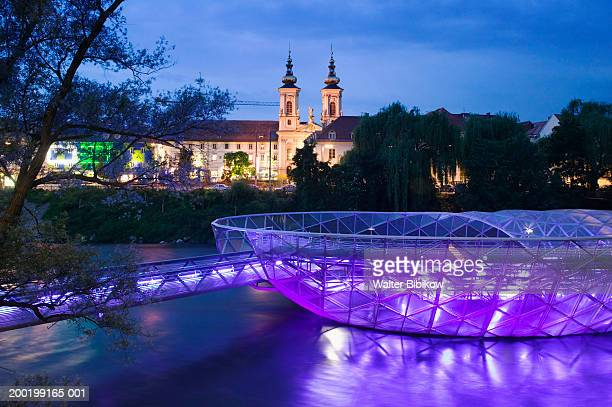 austria, graz, island of the mur at dusk - graz stock photos and pictures