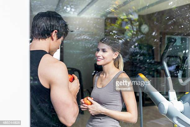 Austria, Klagenfurt, Couple talking in gym