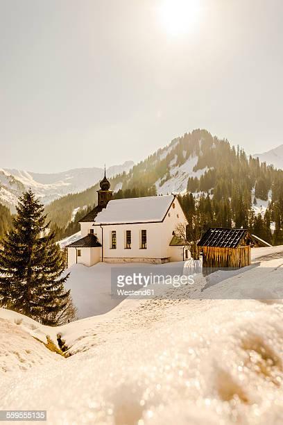 Austria, Kleinwalsertal, Baad, St Martins Church in winter