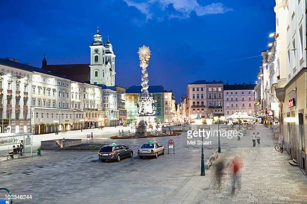 austria, linz, old cathedral with market place - linz stock pictures, royalty-free photos & images