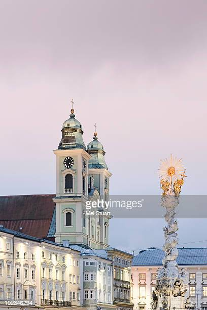 austria, linz, old cathedral with trinity column - linz stock pictures, royalty-free photos & images