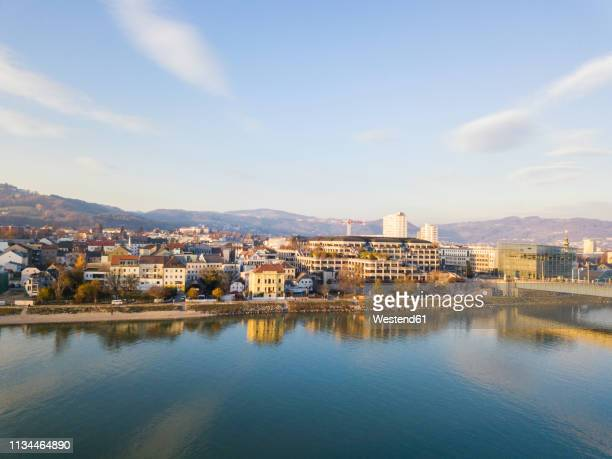 austria, linz, view to the city with danube river in the foreground - linz stock pictures, royalty-free photos & images