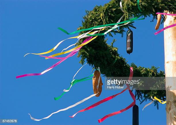 austria, maypole wreath with pretzel and sausage, low angle view - maypole stock pictures, royalty-free photos & images