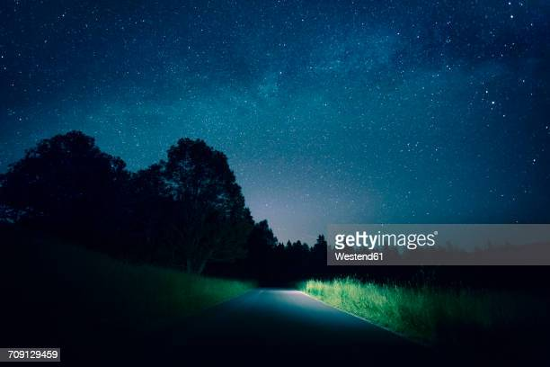 Austria, Mondsee, empty street under starry sky