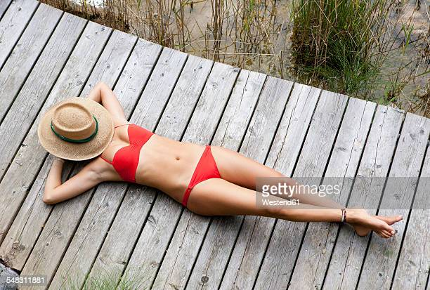 Austria, Mondsee, Teenage girl sunbathing