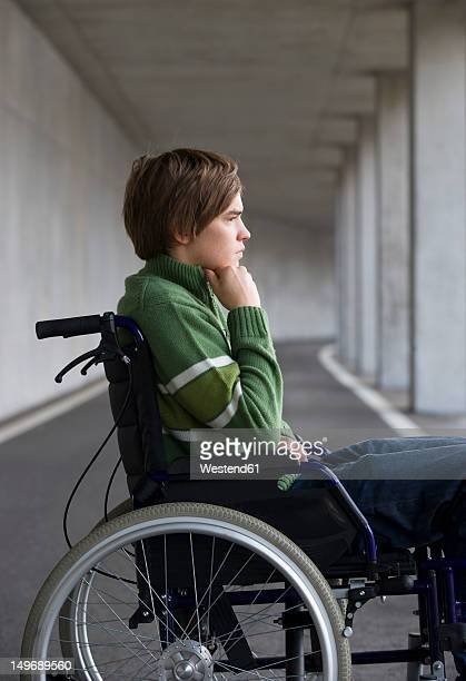austria, mondsee, young man sitting on wheelchair at subway - leaning disability stock pictures, royalty-free photos & images